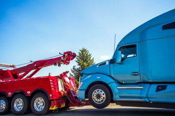 blue-semi-truck-on-red-tow-truck